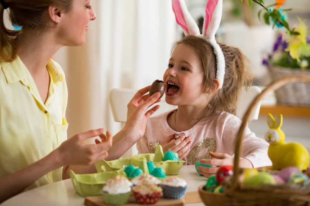 Mother,And,Daughter,Celebrating,Easter,,Eating,Chocolate,Eggs.,Happy,Family